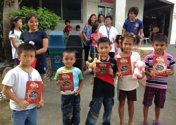 Donating books to children in the Philippines
