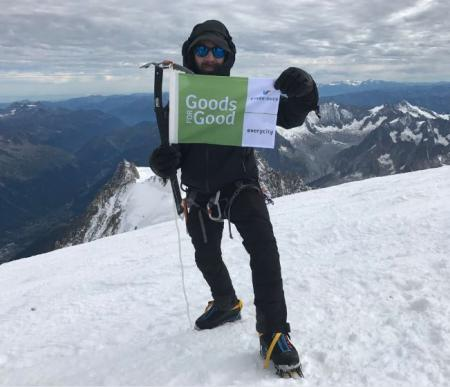 Flying the Goods for Good flag at the summit of Mont Blanc