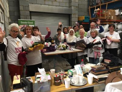 More of our fabulous volunteers at an Interfaith sort and pack session